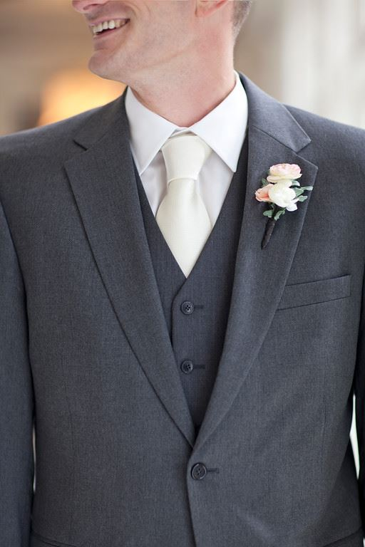 Ivory dress with a groom wearing a white tuxedo jacket for Shirt and tie for charcoal suit