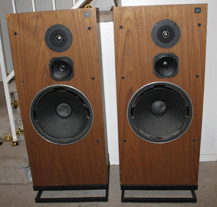 Has anyone here compared JBL L100T with Polk SDA's or