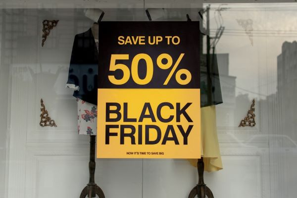 a sale sign saying save up to 50 per cent on top and black Friday at the bottom