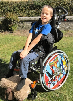 Adam in his wheelchair