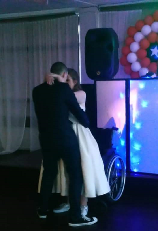 A married couple dancing at a wedding reception