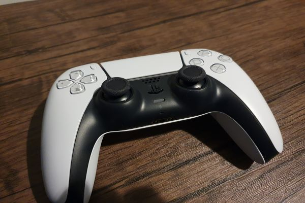 image of the PlayStation 5 controller on a table