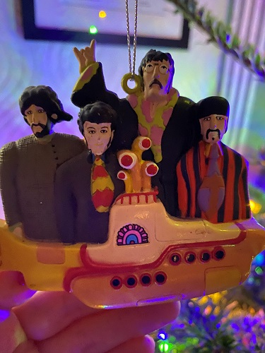 The Beatles huddled together on a yellow submarine