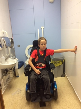A small disabled toilet with inadequate space