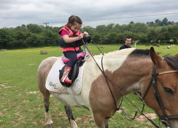 disabled girl riding a horse