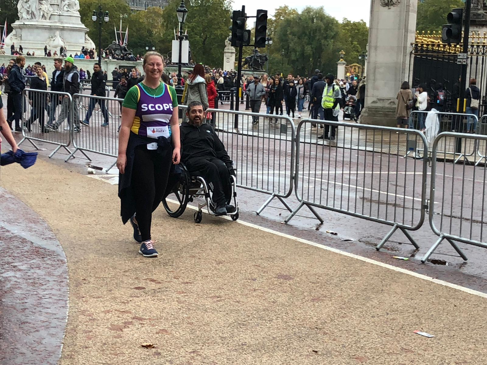 Man in a wheelchair and a woman taking part in the marathon
