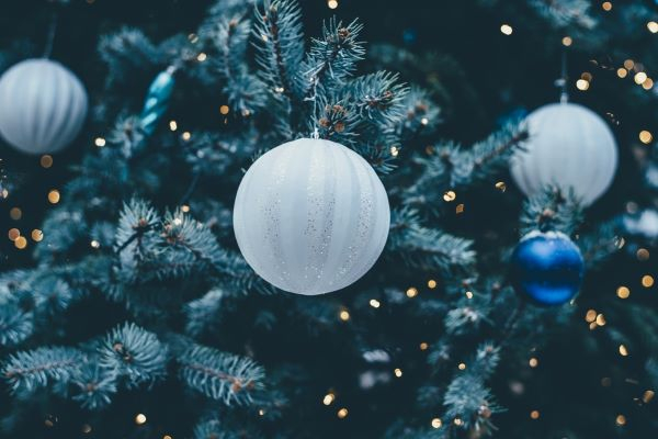 close up image of a white Christmas bauble on a Christmas tree