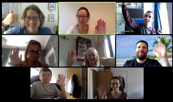 screenshot of people on a video call waving