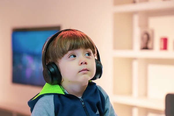 Young boy listening to headphones