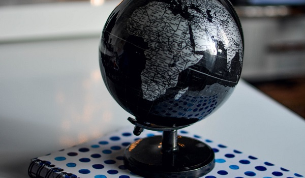 A globe on top of a notebook