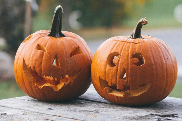two pumpkins calved with a spooky smile
