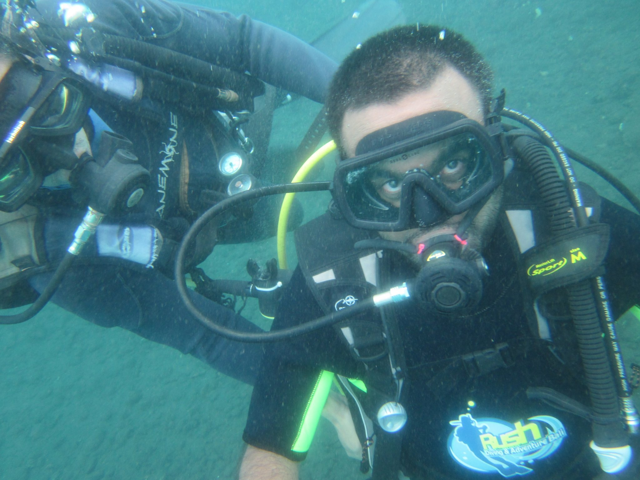 Man underwater with scuba diving equipment