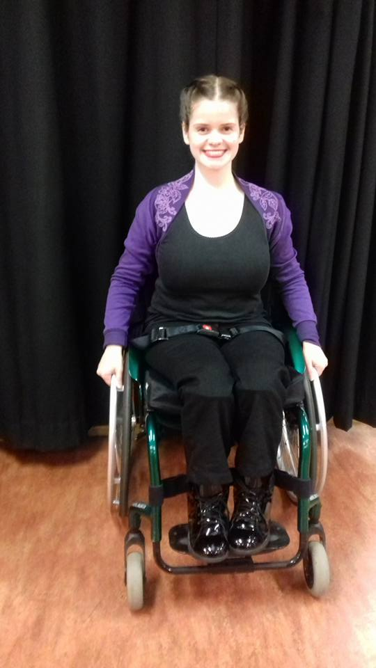 woman in wheelchair smiling
