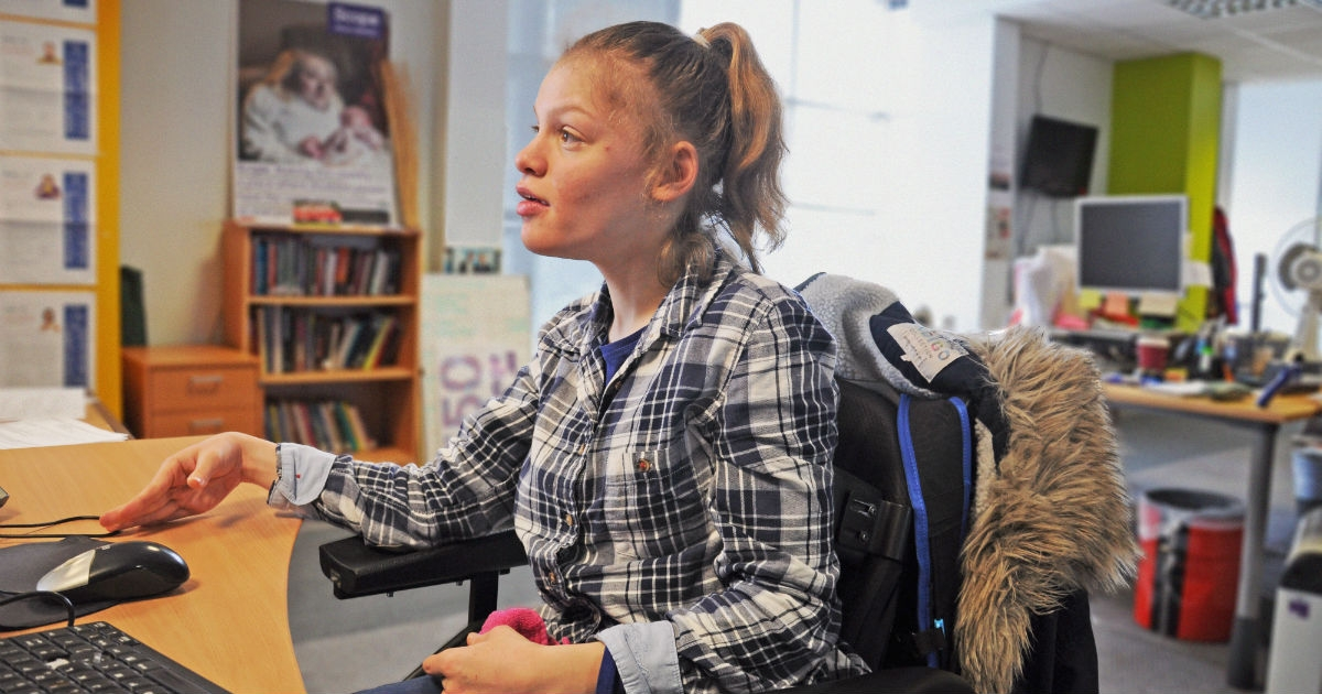 disabled girl sat at computer