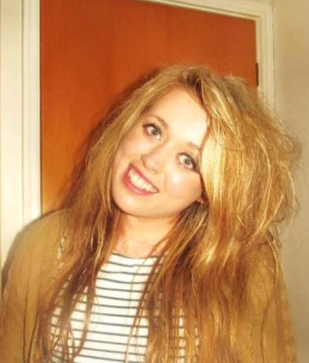 headshot of Merryn before her hospital admission with big blonde hair and wearing a stripy top smiling at the camera
