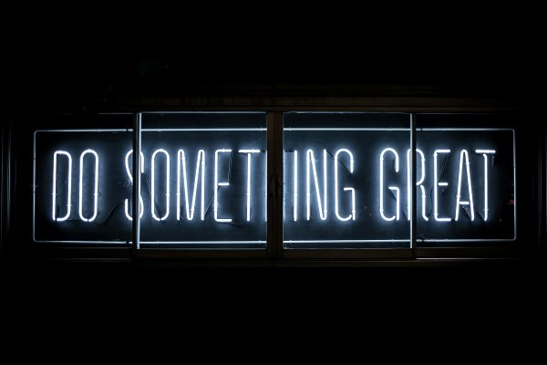 A light sign that says do something great