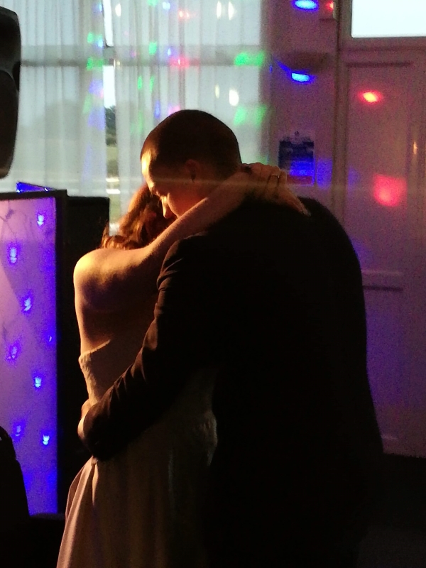 Ami stood dancing with her husband on their wedding day