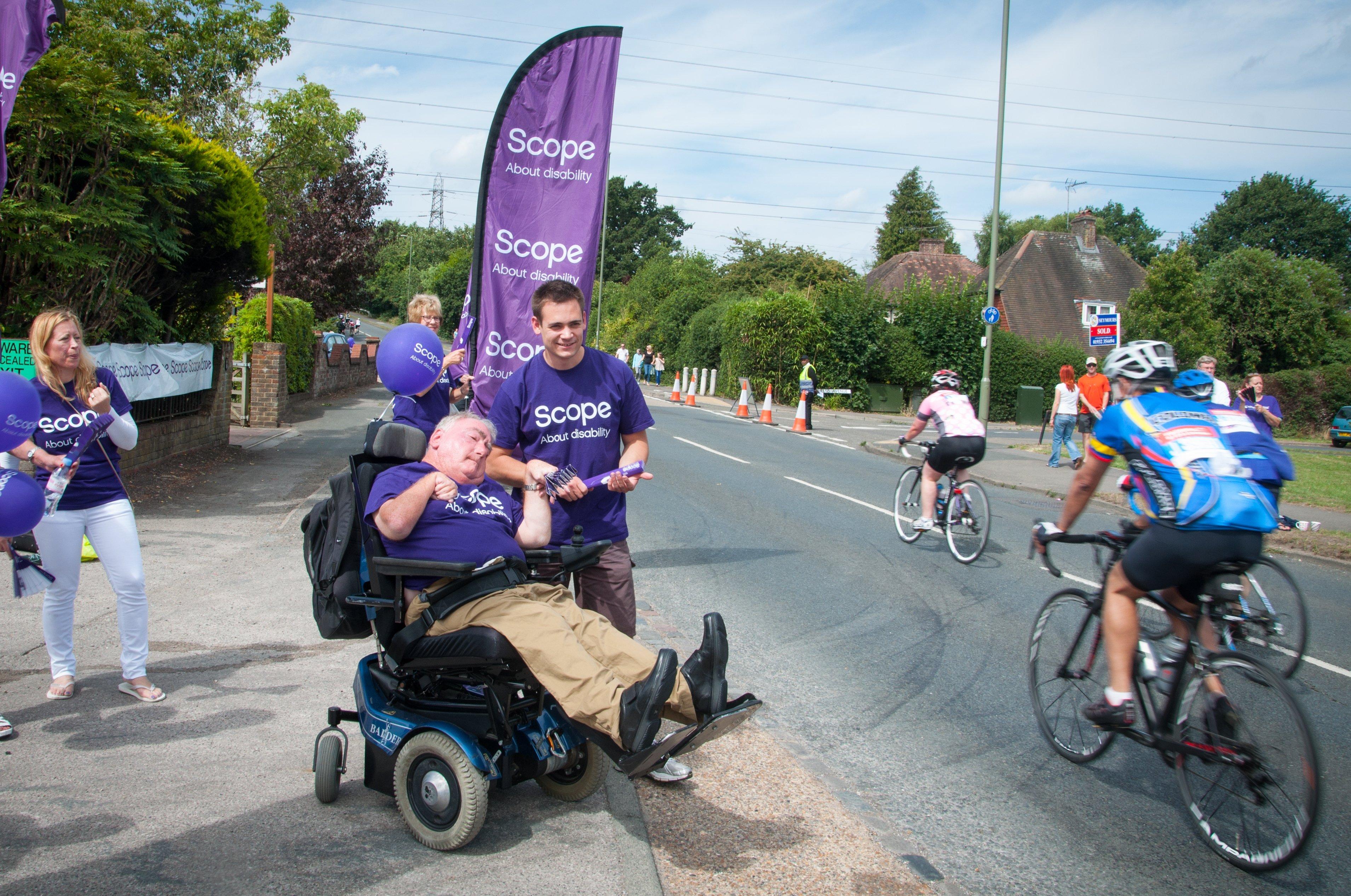 Scope volunteers cheer on cyclists