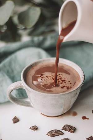 hot chocolate being poured into a cup