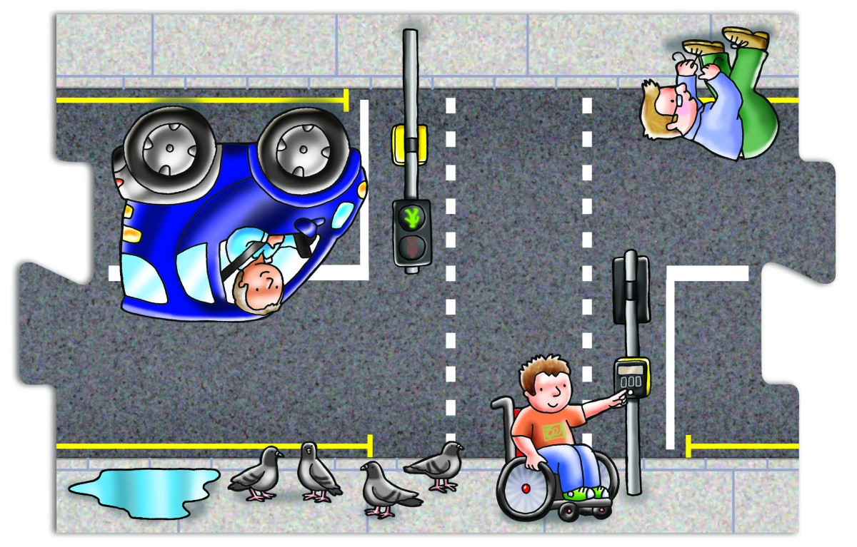 Jigsaw piece showing cartoon of young boy in wheelchair crossing the road