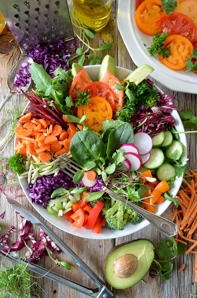 A bowl of brightly coloured salad items