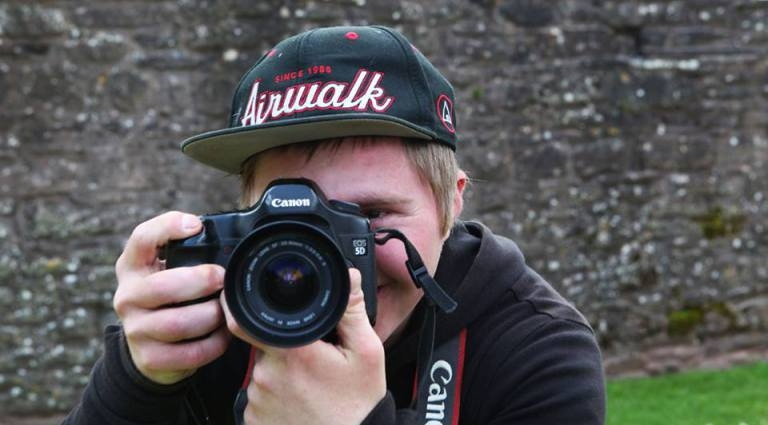 Oliver Hellowell man with down syndrome photographer camera