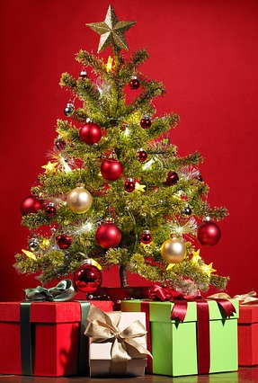 Christmas tree with presents against red background