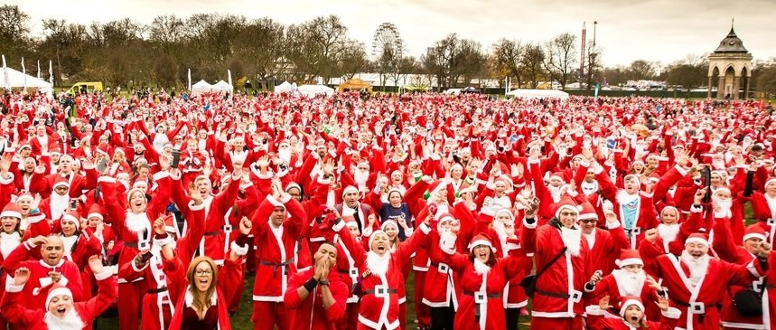hundreds of people dressed as Santa ready to start a race