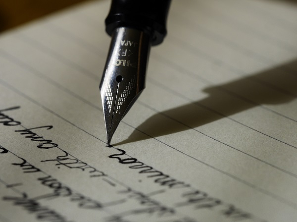 A fountain pen writing on paper