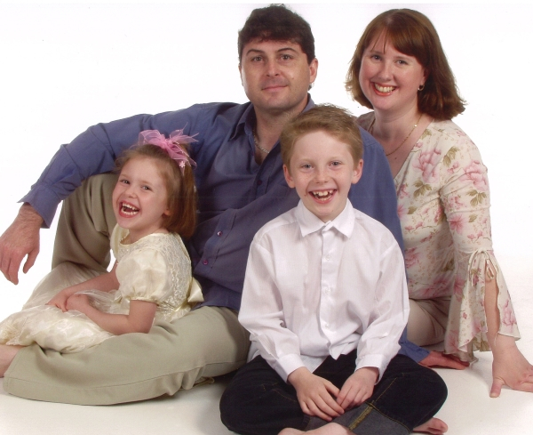 A family photo of a mum and dad and two small children a boy and a girl