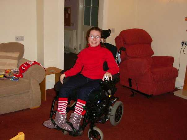 Emma in cottage lounge wearing red  white stripy stockings in Scotland  December 2009