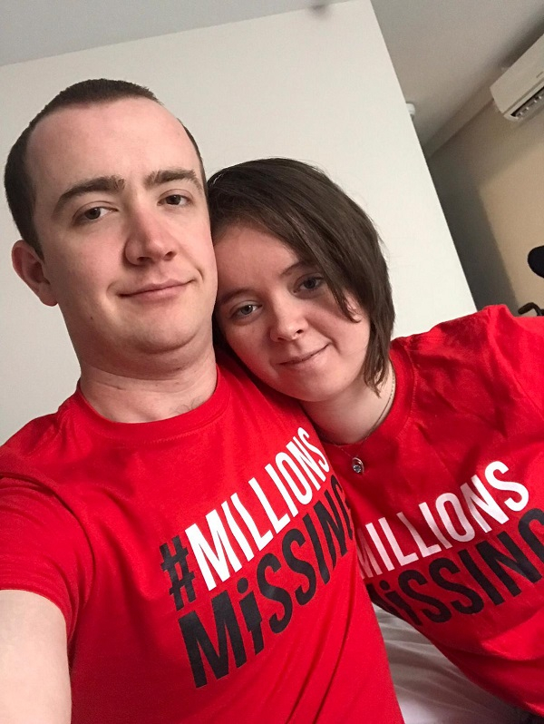 A young man stood beside a young woman both wearing red t-shirts displaying the message MillionsMissing