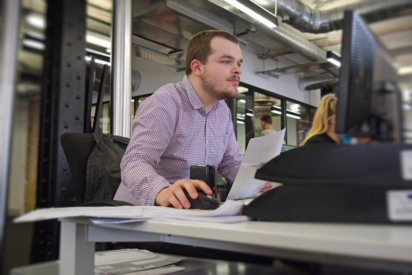 disabled man at computer screen