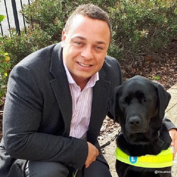 A gentleman with his Guide Dog