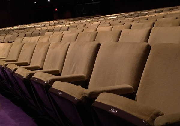 Folding seats in a theatre