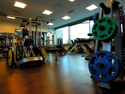 Photo of a gym with weights and different equipment