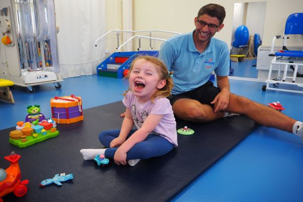 Jack and a young girl at her end assessment