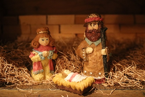 An ornamental Mary Joseph and baby Jesus in the manger