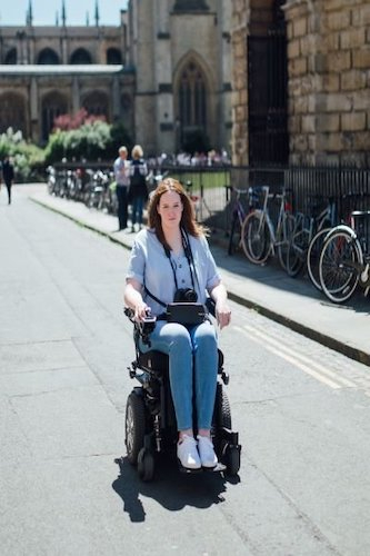 Shona in her wheelchair in a city type landscape