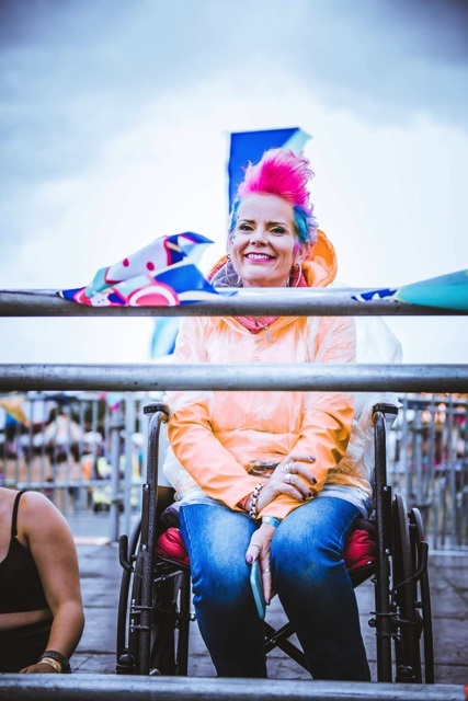 female wheelchair user on viewing platform at festival