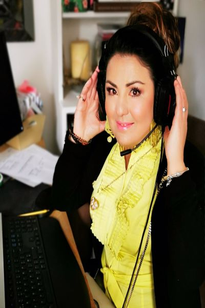 image of a young woman wearing a gaming headset, Maria