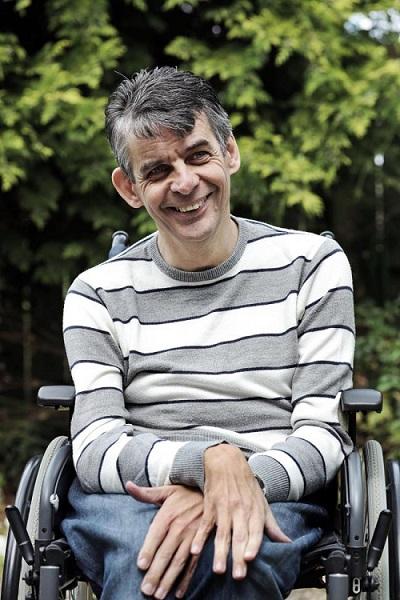 Paul sat smiling in his wheelchair