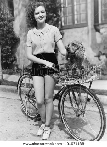 /members/images/699204/Gallery/stock-photo-woman-next-to-her-bicycle-with-her-dog-in-the-basket-91971188.jpg