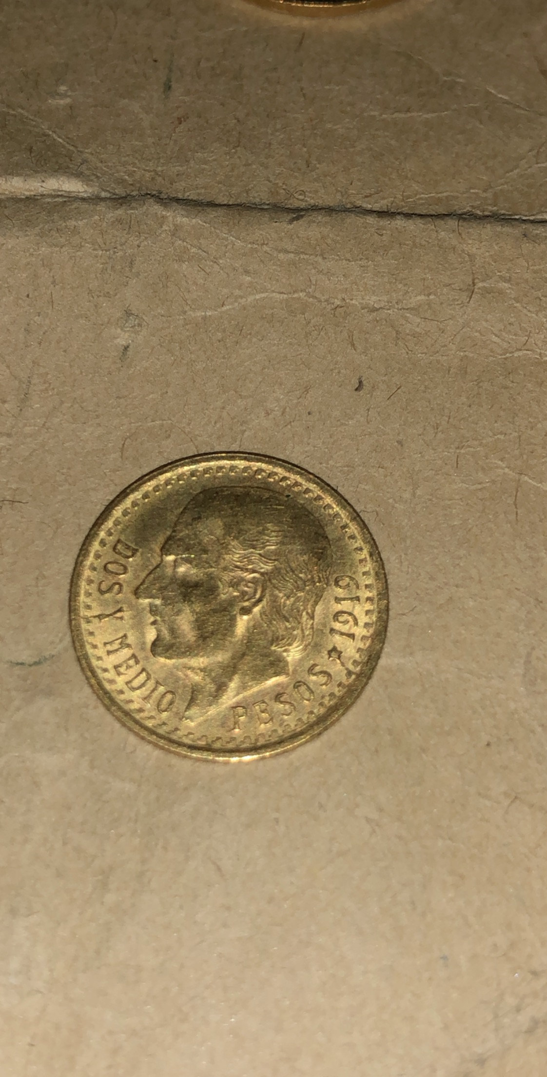 Mexico 1919 2 1/2 peso gold coin hold any value other than