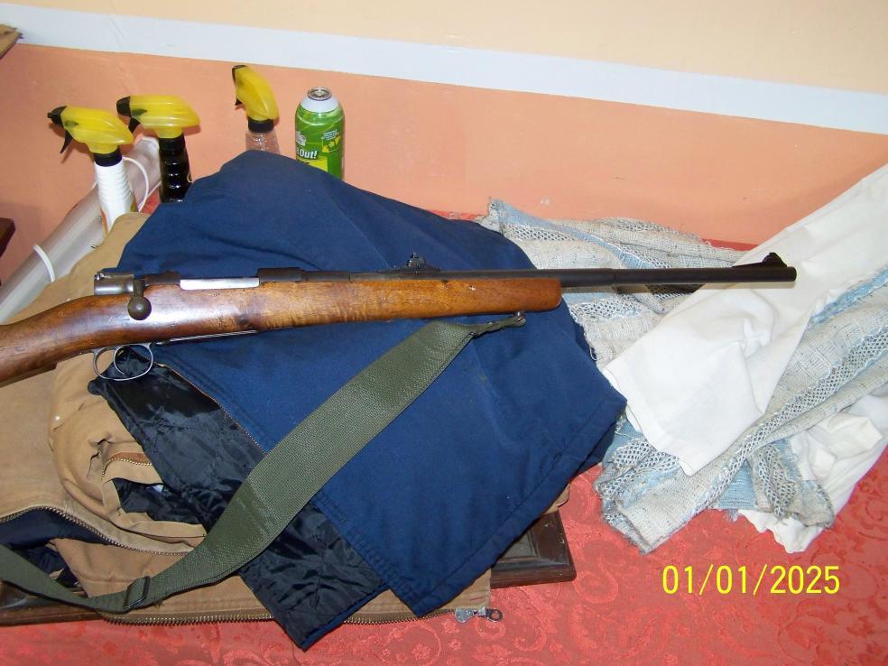 need help identifying my 7mm mauser — gunsandammo