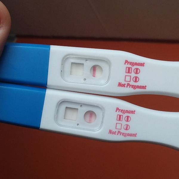 2 very faint positives, one negative, and just started my period