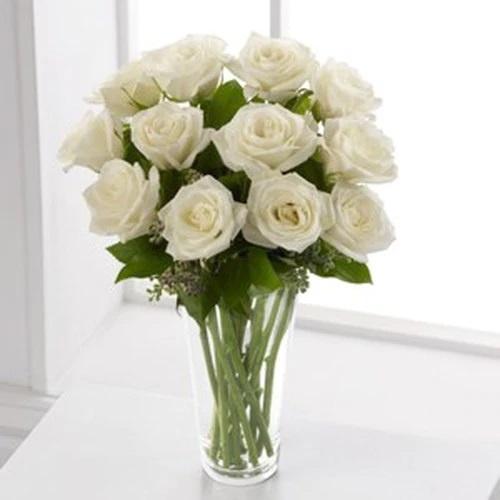 white roses in vase.jpeg