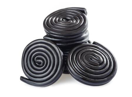 81440623-licorice-candy-and-wheels-isolated-on-white.jpg