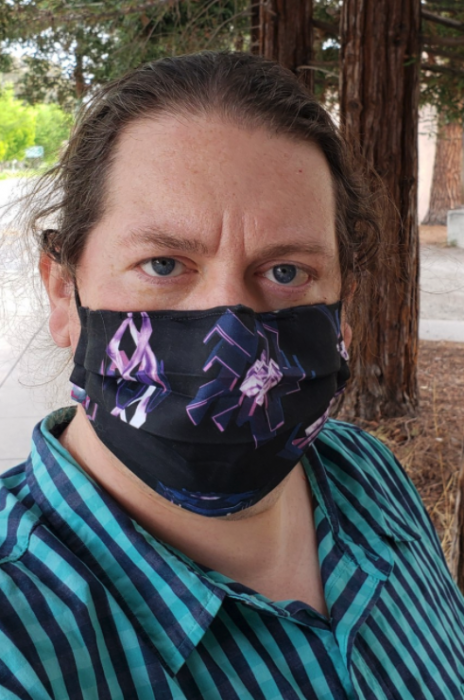 Agent in Weapons of Mass Distraction mask.