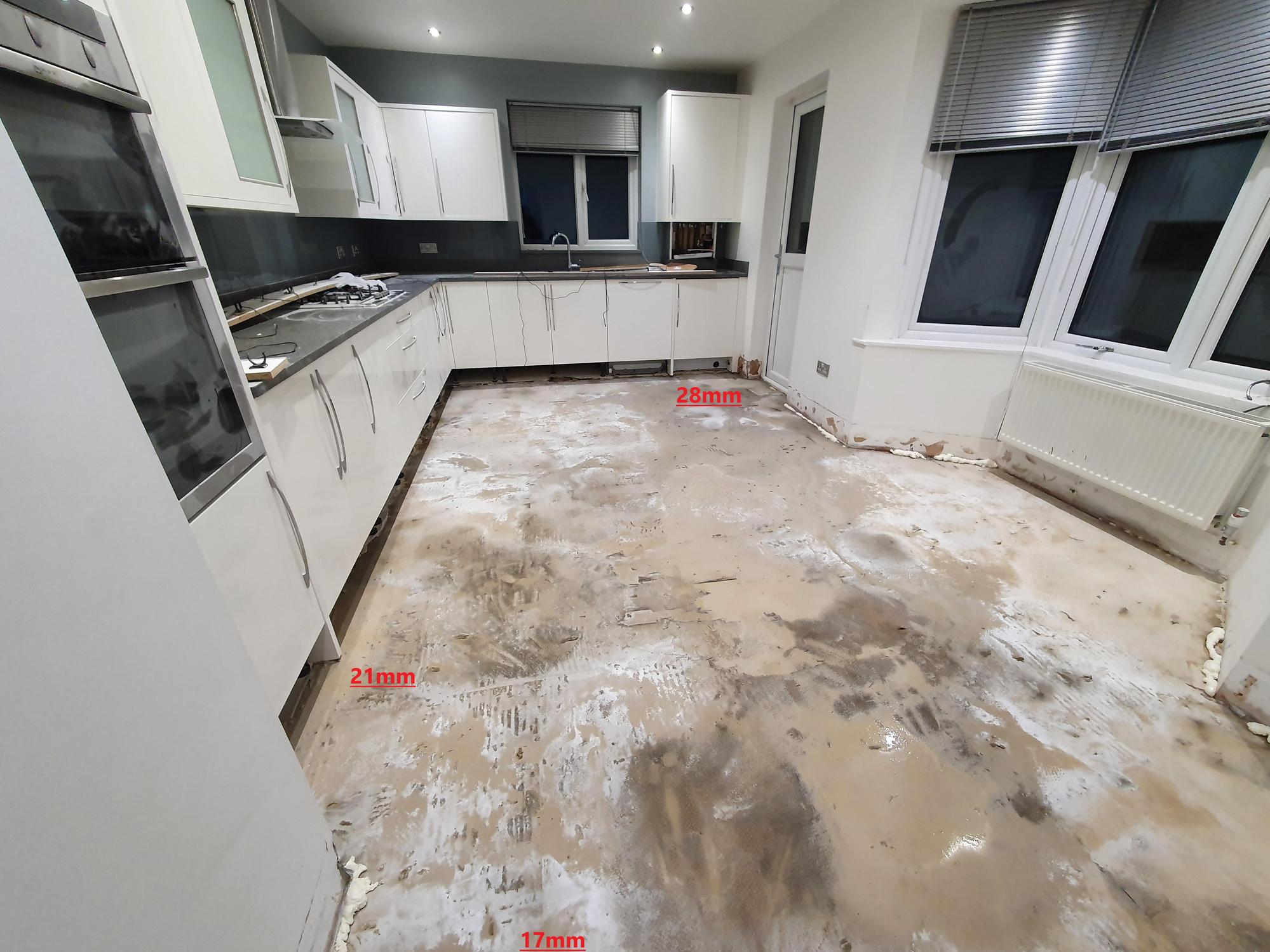 complex kitchen floor tiling repair job uneven floor